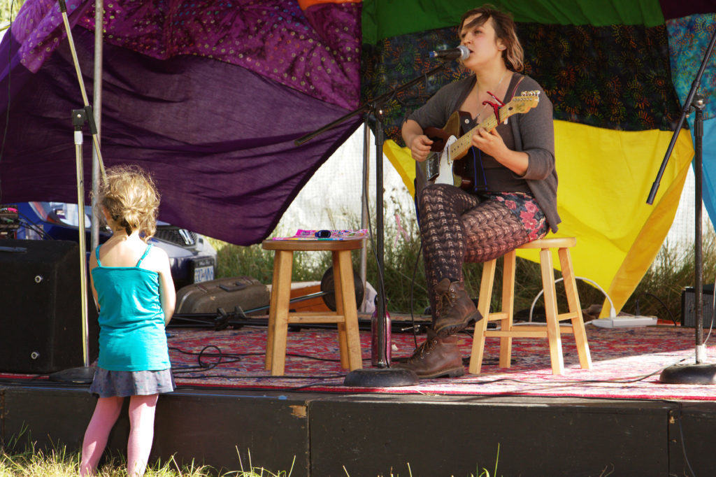 Singer and Child Close to Stage